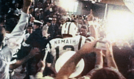 Pro Football Hall of Fame and New York Jets quarterback Joe Namath (12) walks through the national media after being recognized as the game's most valuable player in the Jets 16-7 victory over the Baltimore Colts in Super Bowl III on 1/12/1969 at the Oran Super Bowl III - New York Jets vs Baltimore Colts - January 12, 1969 (AP Photo/NFL Photos)